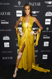 Winnie Harlow styled her dress with sexy nude lace-up heels.