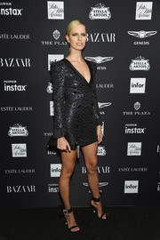 Karolina Kurkova teamed her dress with a pair or crystal-buckled sandals by Roger Vivier.