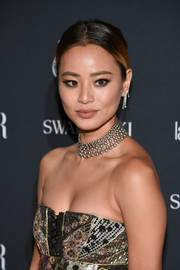 Jamie Chung went for edgy-glam styling with a silver statement necklace.