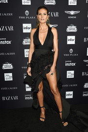 Heidi Klum was sexy-glam in a plunging black fishtail dress by Maticevski at the 2018 Harper's Bazaar Icons event.