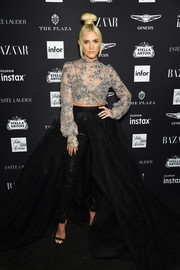 Ashlee Simpson hit the 2018 Harper's Bazaar Icons event wearing a sheer, sequined tulle top by Galia Lahav Couture.