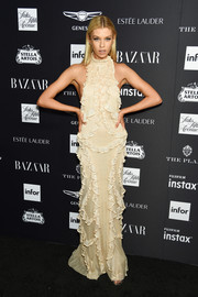 Stella Maxwell chose a nude gown that was adorned with cascading ruffles for the 2018 Harper's Bazaar Icons event.