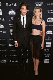 Nicola Peltz completed her barely-there outfit with a sheer tulle skirt, also by Dior.