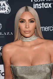 Kim Kardashian sported sleek ash-blonde tresses at the Harper's Bazaar Icons event.