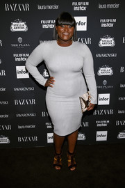 Danielle Brooks styled her dress with a pair of two-tone fur gladiator heels.