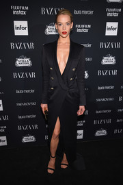 Hannah Ferguson made menswear look so sexy with this floor-sweeping tuxedo dress at the Harper's Bazaar Icons event.
