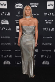 Kim Kardashian was a standout in a vintage Versace chainmail gown at the Harper's Bazaar Icons event.