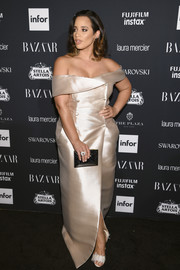 Dascha Polanco continued the elegance with a beveled box clutch.