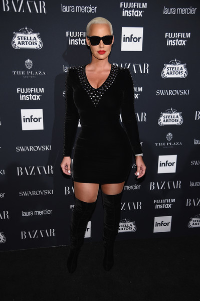 Amber Rose matched her dress with a pair of velvet over-the-knee boots.