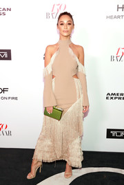 Cara Santana punctuated her neutral look with a lime-green box clutch by Edie Parker.