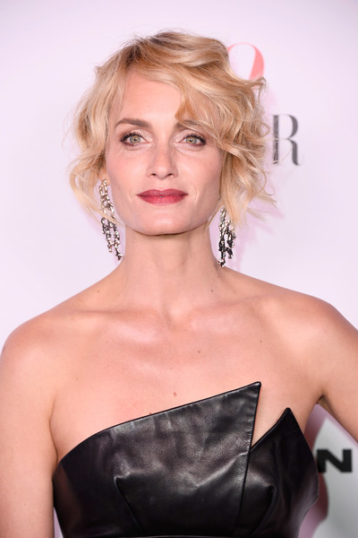 Amber Valletta went for edgy glamour with this messy, curly updo at the Harper's Bazaar 150 Most Fashionable Women celebration.