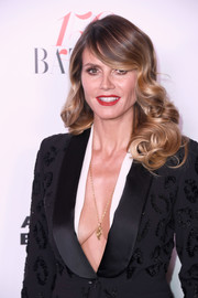 Heidi Klum looked ultra glam with her Old Hollywood curls at the Harper's Bazaar 150 Most Fashionable Women celebration.