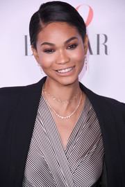 Chanel Iman styled her hair into a simple side-parted ponytail for the Harper's Bazaar 150 Most Fashionable Women celebration.