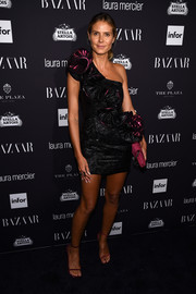 Heidi Klum got all frilled up in a black and purple one-shoulder ruffle dress by Wolk Morais for the Harper's Bazaar Icons event.