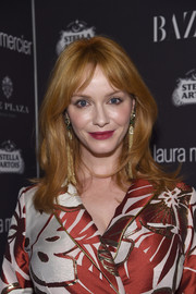 Christina Hendricks wore a slightly wavy 'do with parted bangs at the Harper's Bazaar Icons event.