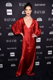 Hilary Rhoda looked quite the diva in a red satin gown with a deep-V neckline and voluminous sleeves during the Harper's Bazaar Icons event.