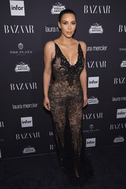 Kim Kardashian showcased her cleavage and voluptuous figure in a sheer black lace gown by Givenchy Couture during the Harper's Bazaar Icons event.