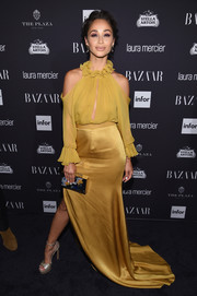 Cara Santana was trendy-glam in a mustard cold-shoulder ruffle blouse by Jenny Packham at the Harper's Bazaar Icons event.