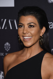 Kourtney Kardashian kept it simple with this brushed-back hairstyle at the Harper's Bazaar Icons event.