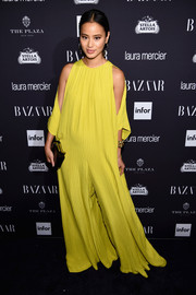 Jamie Chung gave us serious '70s vibes with this bright-yellow wide-leg jumpsuit by Tome that she wore to the Harper's Bazaar Icons event.
