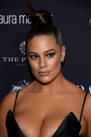 Ashley Graham showed off an exotic top knot at the Harper's Bazaar Icons event.