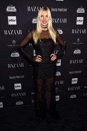 Jessica Hart went goth in a black gown with a sheer yoke, sleeves, and skirt for her Harper's Bazaar Icons look.