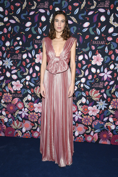 Alexa Chung looked breathtaking in a bowed pink silk gown by Dior Couture at the Harper's Bazaar exhibition.