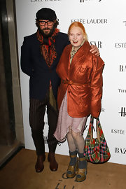 Vivienne Westwood completed her eye-catching get-up at the Woman of the Year Awards with a colorful plaid hobo bag.