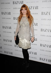 Charlotte Tilburry wore a sparkling dress with a fringed hem for the Harper's Bazaar Women of the Year Awards.