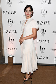 Jenna-Louise Coleman chose a white Emilia Wickstead midi dress with puffed sleeves for the Harper's Bazaar Women of the Year Awards. The slash down the bodice added just a hint of sexiness.