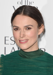 Keira Knightley opted for a low-key center-parted bun when she attended the Harper's Bazaar Women of the Year Awards.