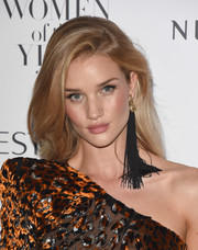 Rosie Huntington-Whiteley jazzed up her look with an oversized black tassel earring by Saint Laurent.