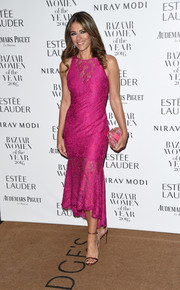 Elizabeth Hurley sheathed her fabulous figure in a fuchsia mermaid-silhouette lace dress by Theia for the Harper's Bazaar Women of the Year Awards.