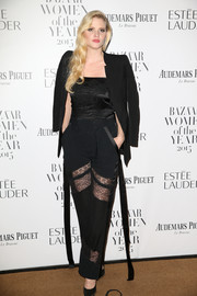 Lara Stone topped off her outfit with a black tux jacket.
