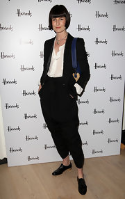 At the Harrods New Technology Department Launch, model Erin O'Connor complemented her look with a pair of black patent flat oxfords.