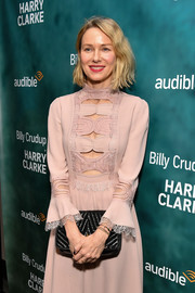 Naomi Watts accessorized with a textured black leather clutch at the 'Harry Clarke' opening.