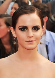Emma Watson experimented with the smoky-eyed look by using hints of gold with this daring beauty look. She finished off the look with full, perfectly groomed brows.