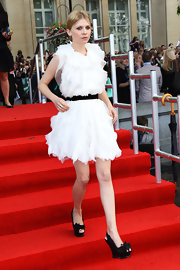 Clemence Poesy teamed her ethereal white ruffle frock with black platform bow wedges at the 'Harry Potter and the Deathly Hallows Part 2' premiere