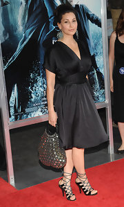 Gina Gershon finished off her look with a sexy pair of black strappy sandals.