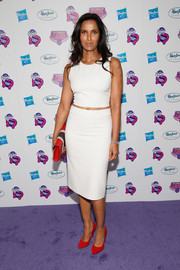 Padma Lakshmi matched her top with a white pencil skirt.