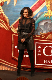 Kerry Washington teamed her girly top with a black leather mini skirt by Sea.