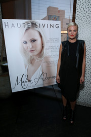 Malin Akerman attended the Haute Living celebration wearing an edgy-chic leather vest, dress, and ankle boots combo.