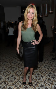 Cat Deeley paired her leather look with a studded pewter leather clutch.