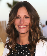 Julia Roberts attended a fundraiser in Santa Monica wearing her signature hairstyle featuring long shiny waves.