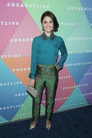 Shiri Appleby look cool and sophisticated in a teal Monique Lhuillier blouse with a beaded collar during the launch of HearstLive.