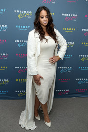 Dascha Polanco looked dramatic in a white opera coat while attending Hearst Magazines' MagFront event.