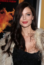 Georgina Chapman showed off her long curls while attending the 'Heartless' premiere. She kept her makeup minimal with a swipe of cherry red lipstick.