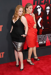 Jessica Chaffin glammed it up in a low-cut black cocktail dress with a metallic gold hem at the premiere of 'The Heat.'
