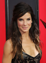 Sporting a messy half-up half-down 'do, Sandra Bullock looked chic with a hint of an edge at the premiere of 'The Heat.'