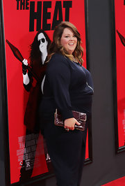 Melissa McCarthy accessorized with a stylish brown snakeskin clutch at the premiere of 'The Heat.'
